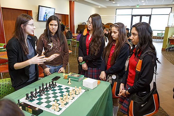 UT Dallas chess team members Patrycja Labedz, Woman FIDE Master, and Cheradee Camacho, Woman International Master, greeted teens from Irma Lerma Rangel Young Women's Leadership School. The teens attended Mae Jemison's lecture as special guests of UT Dallas.